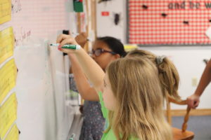 4th Graders Solve Problems on the Board