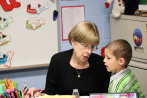 Mrs. Watts with a Kindergarten Student
